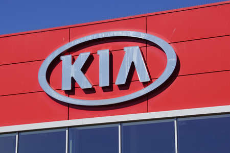 Naarden, the Netherlands - April 19, 2020: Wall logo of KIA against a blue sky.