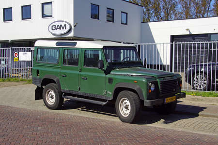 Naarden, the Netherlands - April 19, 2020: Green Land Rover Defender 110 2.5 STORM parked by the side of the road. Nobody in the vehicle.