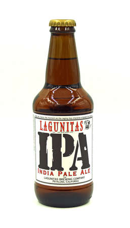 Petaluma, California - April 30, 2020: Bottle of Lagunitas India Pale Ale (IPA) against a white background.