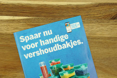 Zaandam, the Netherlands - May 3, 2020: Dutch savings book for food containers issued by grocery store Albert Heijn (AH). Editorial