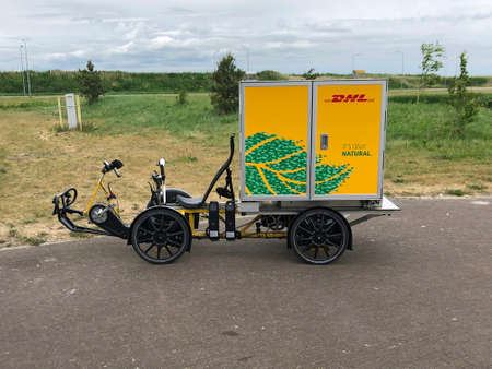 Almere, the Netherlands - May 22, 2020: DHL inner-city Electric Delivery Cargo Bike.