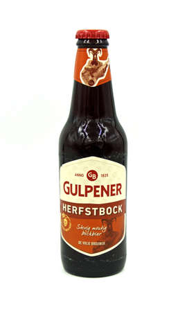 Gulpen, the Netherlands - May 29, 2020: Bottle of Gulpener Autumnbock beer against a white background.