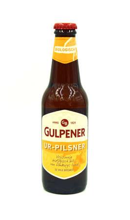 Gulpen, the Netherlands - May 29, 2020: Bottle of Gulpener Ur-pilsner beer against a white background. Editorial