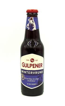 Gulpen, the Netherlands - May 29, 2020: Bottle of Gulpener Wintervrund beer against a white background.