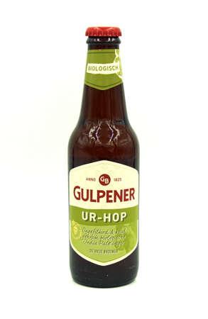 Gulpen, the Netherlands - May 29, 2020: Bottle of Gulpener Ur-Hop beer against a white background.