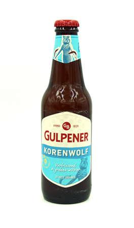 Gulpen, the Netherlands - May 29, 2020: Bottle of Gulpener Korenwolf beer against a white background. Editorial