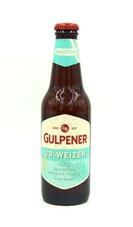 Gulpen, the Netherlands - May 29, 2020: Bottle of Gulpener Ur-Weizen beer against a white backgroud.