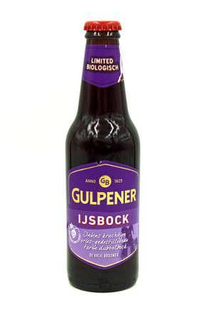 Gulpen, the Netherlands - May 29, 2020: Bottle of Gulpener IJsbock beer against a white background.
