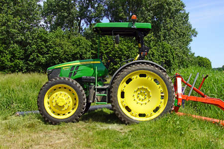 Almere, the Netherland - June 1, 2020: John Deere 5075 e standing on a field.