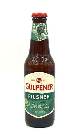 Gulpen, the Netherlands - May 29, 2020: Bottle of Gulpener Pilsener beer against a white background. Editorial