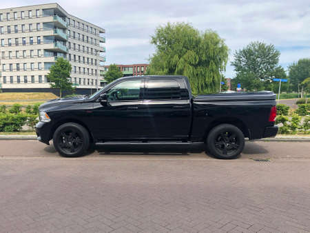 Almere, the Netherland - June 1, 2020: Black Dodge Ram pick up parked on a public parking lot. Nobody in the vehicle. Editorial