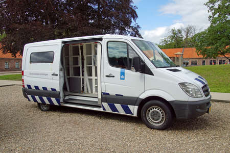 Veenhuizen, the Netherlands - July 29, 2020: Dutch prisoner van parked by the side of the road. Nobody in the vehicle.