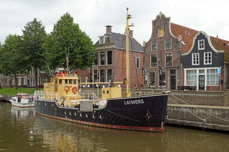 Dokkum, the Netherlands - July 16, 2020: Dutch buoy layer ship Lauwers in the harbor of Dokkum.