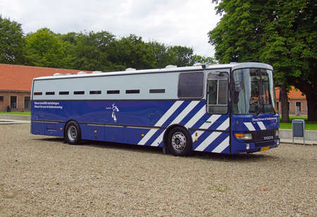 Veenhuizen, the Netherlands - July 29, 2020: Dutch prisoner bus parked by the side of the road. Nobody in the vehicle.
