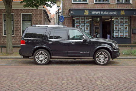 Medemblik, the Netherlands - July 22, 2020: Black Lincoln Navigator parked by the side of the road. Nobody in the vehicle.