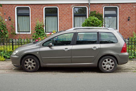 Pieterburen, the Netherland - July 16, 2020: Peugeot 307 SW parked on a public parking lot. Nobody in the vehicle. 報道画像