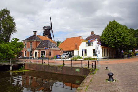 Eenrum, the Netherland - July 15, 2020: Historical town center of the small Dutch town of Eenrum against a clouded sky.