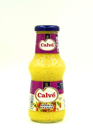 Zaandam, the Netherlands - September 13, 2020: Bottle of Calve Curry Pineapple sauce.