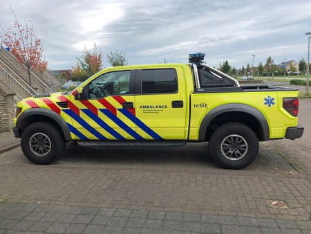 Almere, the Netherland - September 27, 2020: Ford Raptor F150 in Dutch Ambulance striping parked on a public parking spot. Editorial