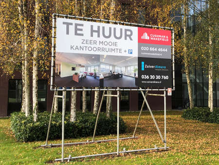Almere, Flevoland, the Netherlands - October 24, 2020: Dutch billboard sign advertising for office rental in the city of Almere.
