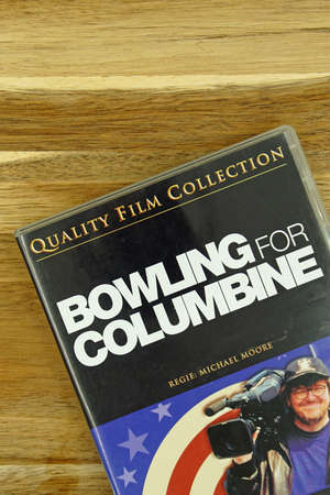 Amsterdam, the Netherlands - November 1, 2020: DVD cover Bowling for Columbine against a wooden background. Editorial