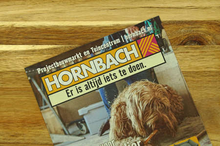 Amsterdam, the Netherlands - November 1, 2020: Garden and Hardware store sale flyer of retail chain Hornbach, against a wooden background.