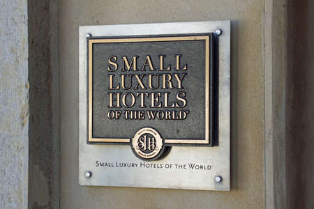 Faro, Portugal - December 27, 2019: Small Luxury Hotels of the World wall advertisement sign. Editorial