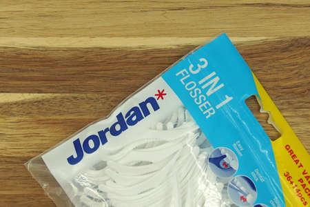 Zaandam, the Netherlands - November 21, 2020: Package of Jordan 3 in 1 Flosser against a wooden background. Editorial