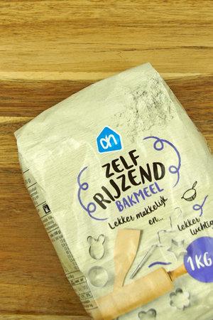 Zaandam, the Netherlands - November 21, 2020: Package of Albert Heijn self-raising flour against on a kitchen table. Editorial