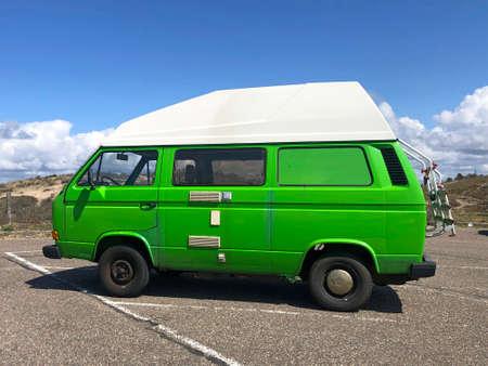 Noordwijk, the Netherland - May 2, 2021: Green Volkswagen Transporter T3 camper parked on a public parking lot. Editorial