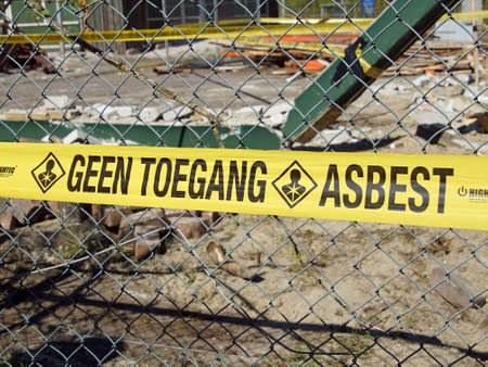 Katwijk, the Netherlands - April 27, 2021: Dutch attention sign warning for prohibited access due to asbestos. Editorial