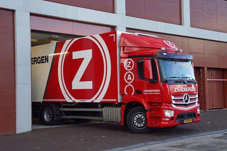 Amsterdam, the Netherland - January 23, 2021: Jan Zandbergen transport truck at a loading dock. Nobody in the vehicle. Editorial