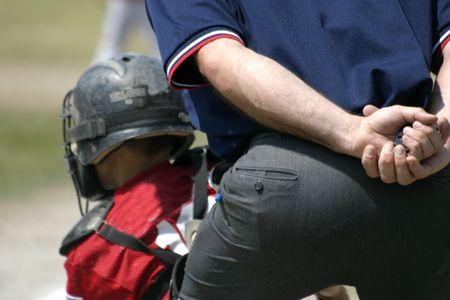 Little league umpire and catcher