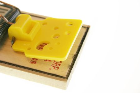 Mousetrap against white background