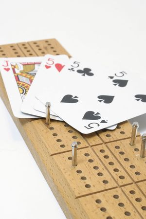 Cribbage board and cards Editorial