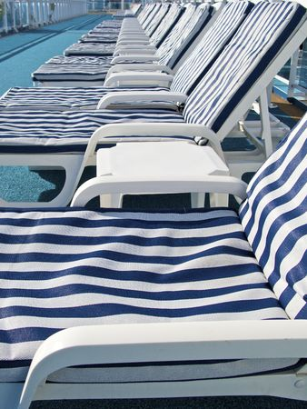 Blue-striped lounge chairs on deck