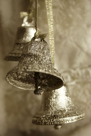 silver bells: Sepia toned image of three silver bells