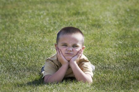 exasperated: Young boy with exasperated expression