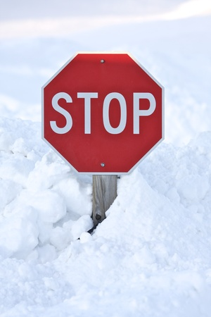 snow drift: Stop sign buried by snow drift Stock Photo