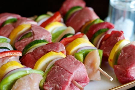 Beef and chicken Shish Kabobs ready for the grill Stock Photo