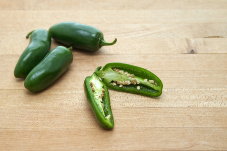 Jalapeño peppers on cutting board
