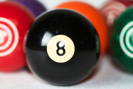 Vintage billiard balls with eight ball in focus