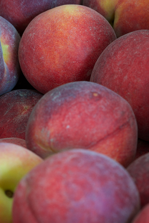Close up of fresh peaches in a produce box