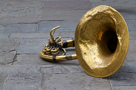 tuba: A well used tuba lies on the ground in Jackson Square, New Orleans Stock Photo