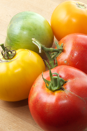 Rustic tomatoes, red, green, yellow