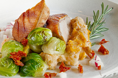 Duck breast and brussel sprouts served at a restaurant Stock Photo