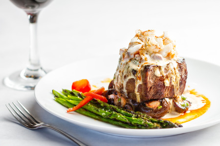 crab: A plated meal of steak and crab meat