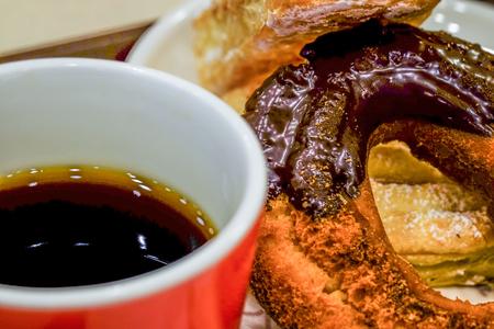 making hole: chocolate donut cake and coffee