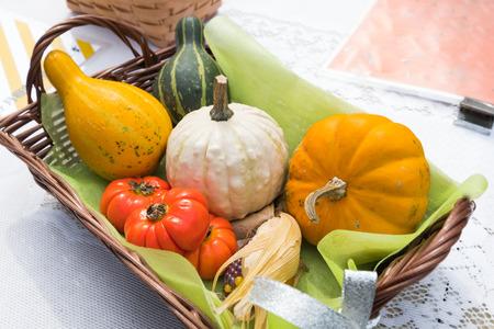 Halloween pumpkins in wooden basket