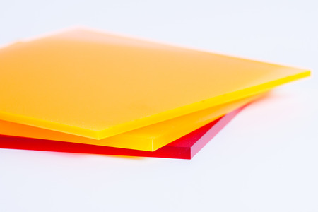 white sheet: Orange yellow and red plexi glass sheets on the white background Stock Photo